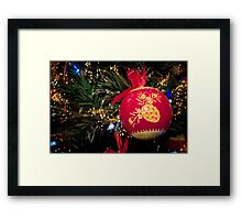 Red Christmas ball with retro ornament on Christmas tree Framed Print