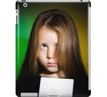 Cute little girl with long hair showing book, on colorful background iPad Case/Skin
