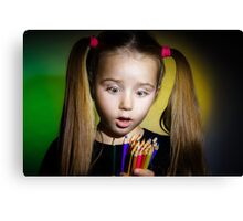 Cute little girl with colorful pencils, on yellow-green background Canvas Print