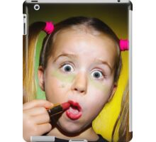 Funny little girl making make-up by herself, on colorful background iPad Case/Skin