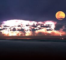Lightning storm with full moon over the beach by Gary Blackman