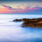 Rocks and pink clouds by Ralph Goldsmith