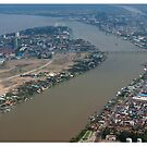 Confluence of the Mekong and Tonle Sap River. by stuwdamdorp