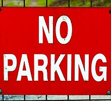 Closeup on red NO PARKING sign by Stanciuc