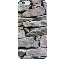 Closeup on a dry stone wall in yorkshire countryside, UK. Building materials pattern iPhone Case/Skin