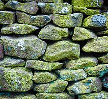 Closeup on a dry stone wall in yorkshire countryside, UK. Building materials pattern by Stanciuc
