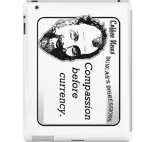 Compassion before currency iPad Case/Skin