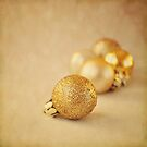 Gold glittery Christmas baubles by Lyn  Randle