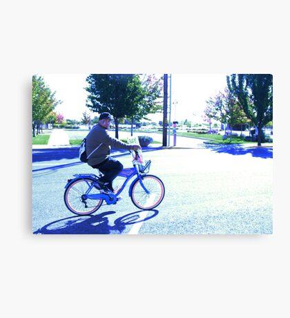 Man on a Bike Canvas Print