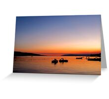 Two pedal boats in the sunset Greeting Card