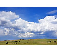 Beautiful cloudscape over rolling green hills Photographic Print