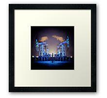 Oil Rigs at night. Framed Print