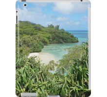 Secluded sandy beach with lush tropical vegetation iPad Case/Skin