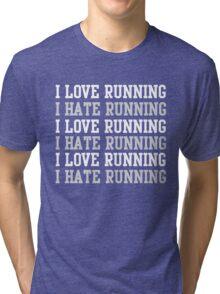 I love running. I hate running.  Tri-blend T-Shirt