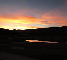 Sunset Over a Golf Course  by DevinStar
