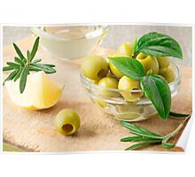 Glass cup with green pitted olives decorated with herbs Poster