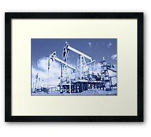 Pump jack on a oilfield. Toned. Framed Print