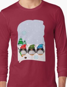 Hockey Penguins with snowflakes hats in a snowy landscape Long Sleeve T-Shirt