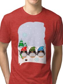 Hockey Penguins with snowflakes hats in a snowy landscape Tri-blend T-Shirt
