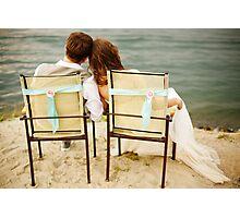 Newlyweds couple sitting near water on the beach Photographic Print