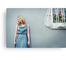 Fashion portrait of young woman near wall Canvas Print