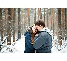 Couple in love having fun in winter forest Photographic Print