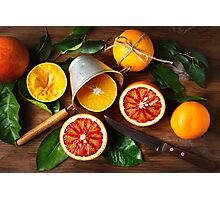 Still life with orange fruit and green leaves Photographic Print