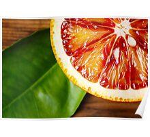 Blood orange fruit close up on wooden table Poster
