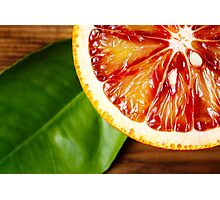 Blood orange fruit close up on wooden table Photographic Print