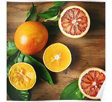 Different sort of orange fruit on wooden table Poster