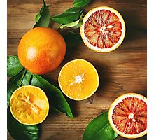 Different sort of orange fruit on wooden table Photographic Print