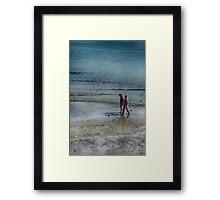 walking on the sand Framed Print