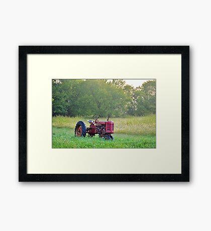 Red Farm Tractor At Rest Framed Print
