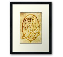 Never grow up. Framed Print