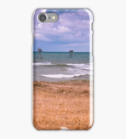 Fishing rigs in sea. iPhone Case/Skin