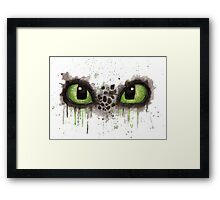 Toothless' eyes in watercolour Framed Print