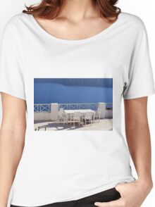 Table and chairs by the sea in Santorini,Greece Women's Relaxed Fit T-Shirt