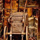 Old wheelbarrow by Karen  Betts