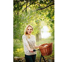 Woman on a vintage bicycle in the countryside Photographic Print