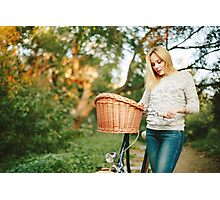 Young blonde woman on a vintage bicycle  Photographic Print