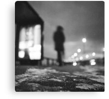 Man waiting at bus stop at night in winter square black and white analogue medium format film Hasselblad  photo Canvas Print