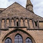 Arcade on exterior south transept  Pershore Abbey Pershore England 198405140042 by Fred Mitchell
