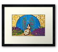 Girl and old painted gate.jpg Framed Print