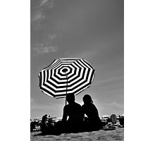 Silhouetted Couple & a Striped Sun Umbrella Photographic Print