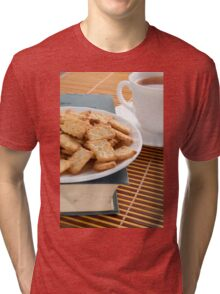 White plate with cookies on the old book Tri-blend T-Shirt