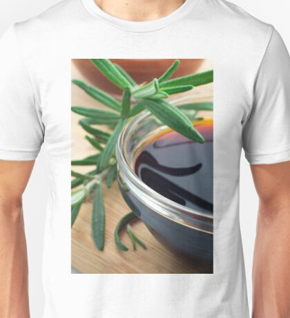 Glass cup with soy sauce and rosemary leaves closeup Unisex T-Shirt