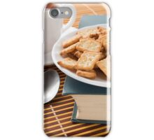 White plate with cookies on the old book  iPhone Case/Skin