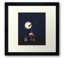 Witch in a graveyard night Framed Print