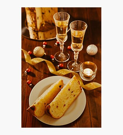 Sliced italian panettone, sparkling wine and decorations over a table Photographic Print