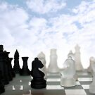 chess pieces isolated against blue sky by morrbyte